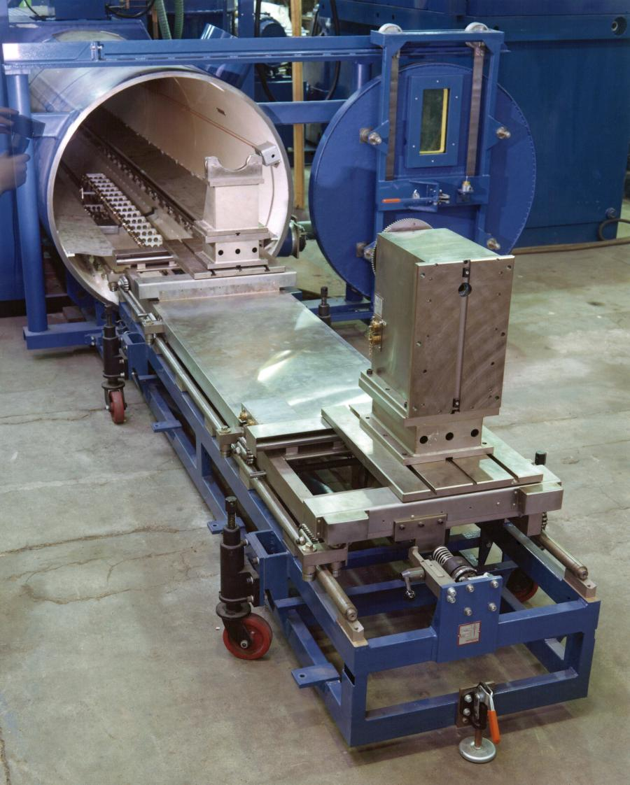 Leybold tube welder with circular chamber, 'roll up' style runout platform.